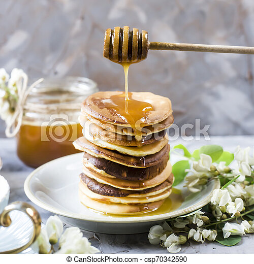 Homemade pancakes stacked on a gray background - csp70342590