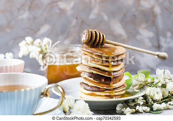 Homemade pancakes stacked on a gray background - csp70342593