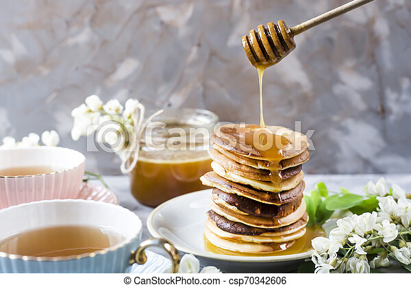 Homemade pancakes stacked on a gray background - csp70342606