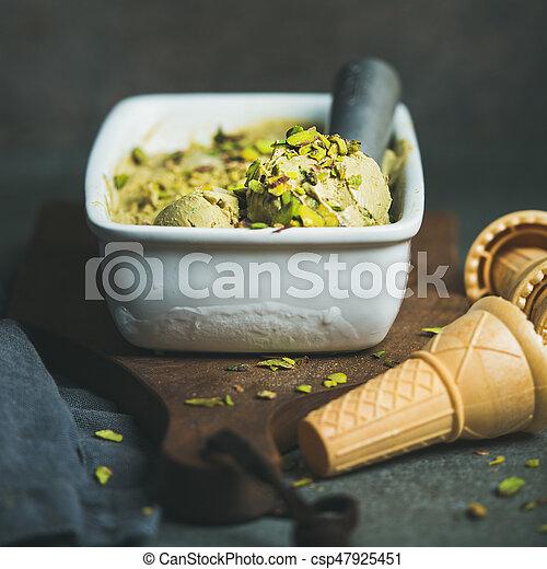 Homemade pistachio ice cream in ceramic mold, square crop