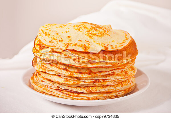 homemade russian thin tasty pancakes on the plate. - csp79734835