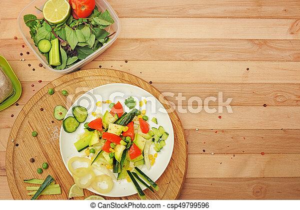 Homemade summer salad, cooking at home - csp49799596
