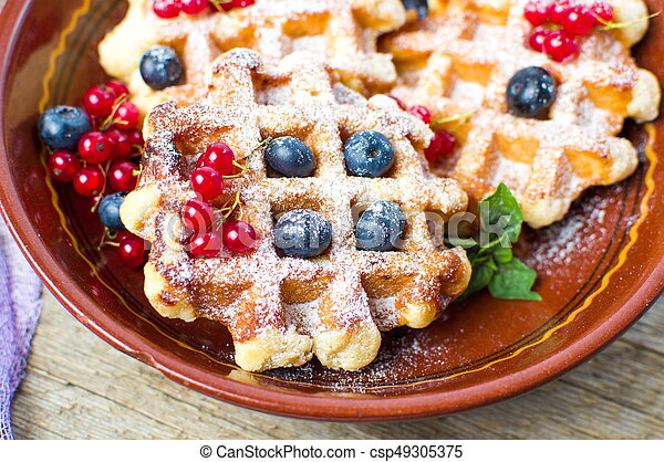 Homemade waffles with fresh berry fruit - csp49305375