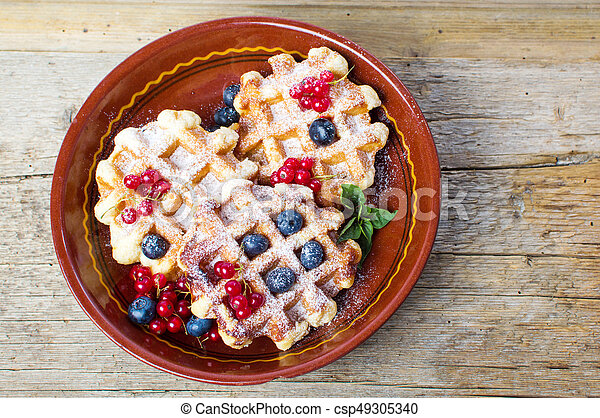Homemade waffles with fresh berry fruit - csp49305340