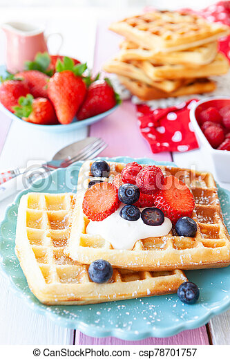 Homemade waffles with fresh fruits - csp78701757