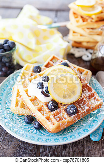 Homemade waffles with fresh fruits - csp78701805