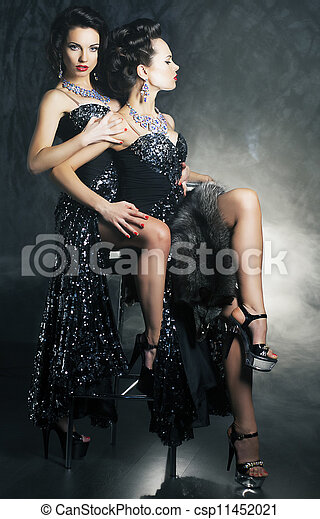 Homosexual couple of young flirting women in erotic pose - csp11452021