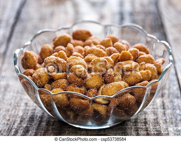 Honey coated peanuts - csp53738584
