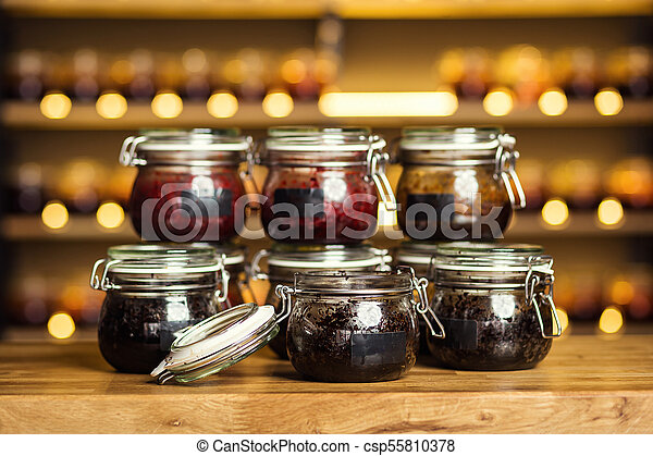 Hookah tobacco in glass banks with different taste standing on the bar  counter  Shisha Concept