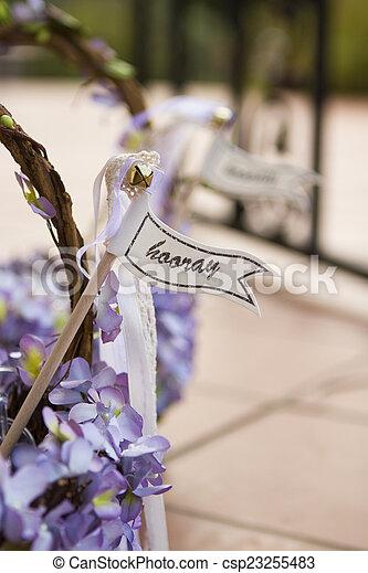 Hooray sign on a wedding basket - csp23255483