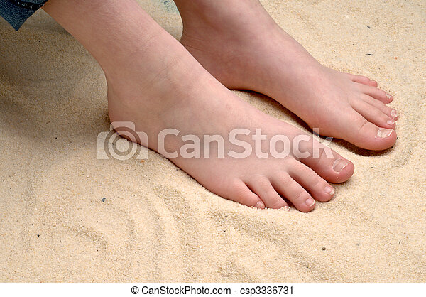 horizontal image of a childs feet in the sand - csp3336731