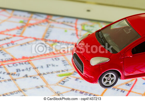 horizontal photo of closeup red car toy on the map in tablet screen - csp41437213