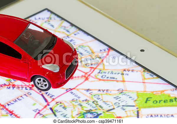 horizontal photo of closeup red car toy on the map in tablet screen - csp39471161