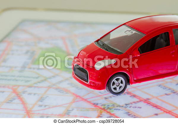 horizontal photo of closeup red car toy on the map in tablet screen - csp39728054