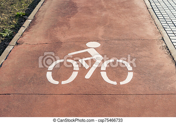 Horizontal sign painted on the ground of a bike lane of a city enabling bicycle circulation - csp75466733