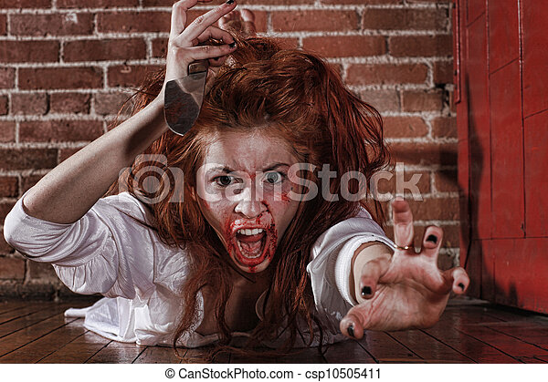 Horror Themed Image With Bleeding Frightened Woman - csp10505411