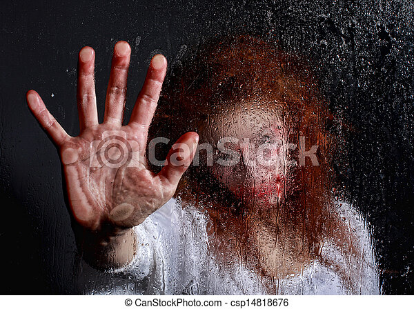 Horror Themed Image With Bleeding Frightened Woman - csp14818676