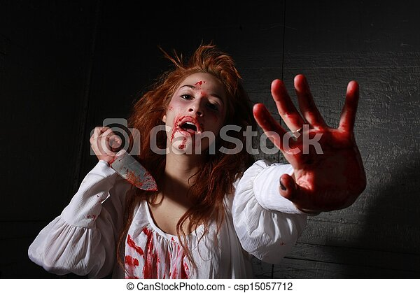 Horror Themed Image With bleeding frightened Woman - csp15057712
