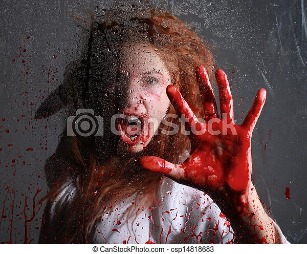 Horror Themed Image With Bleeding Frightened Woman - csp14818683
