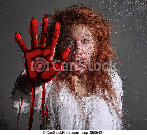 Horror Themed Image With Bleeding Frightened Woman - csp10505421
