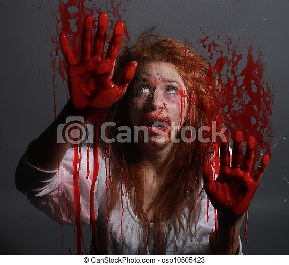 Horror Themed Image With Bleeding Frightened Woman - csp10505423