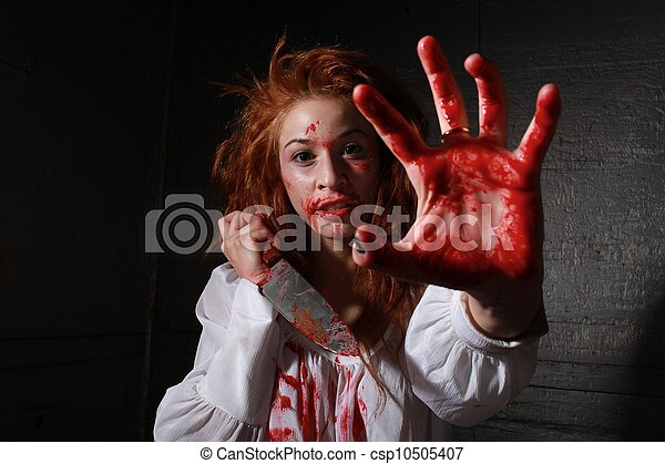 Horror Themed Image With Bleeding Frightened Woman - csp10505407