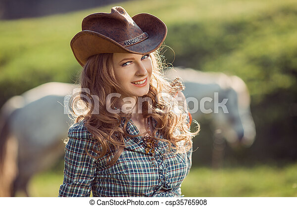 Horse and girl with cowboy hat. Portrait of young cowgirl and horse ... 89862699d05