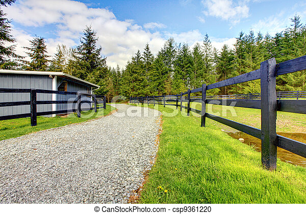 Horse farm with road, fence and shed. - csp9361220