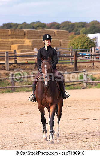 Horse to relax with a young rider before a contest - csp7130910
