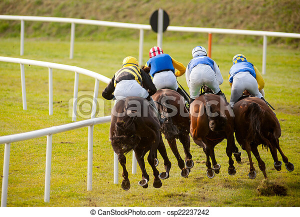 horses racing the track - csp22237242
