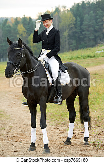 horsewoman jockey in uniform with horse - csp7663180