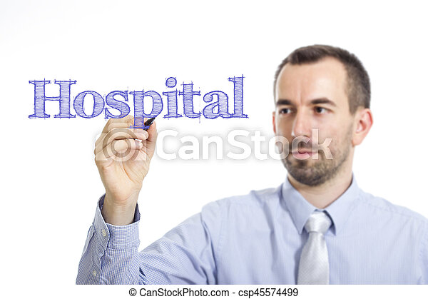 Hospital - Young businessman writing blue text on transparent surface - csp45574499