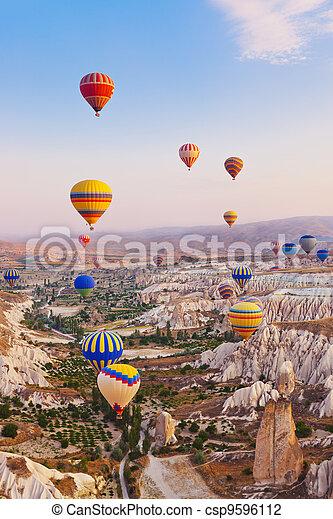 Hot air balloon flying over Cappadocia Turkey - csp9596112