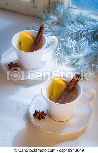 Hot and aromatic tea with orange for Christmas - csp40943049
