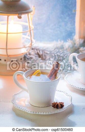Hot and sweet tea with cinnamon for Christmas - csp61500460