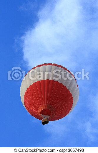 Hot ballon against blue sky - csp13057498