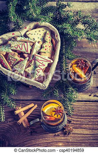 Hot Christmas sweet tea with cookies - csp40194859