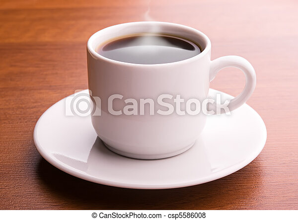 Hot coffee on a table - csp5586008