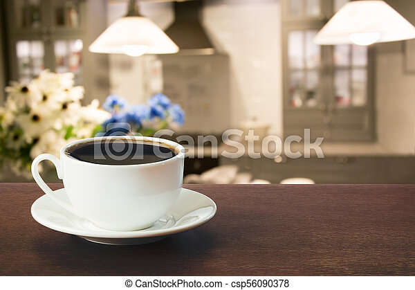Hot coffee on tabletop in modern kitchen. - csp56090378