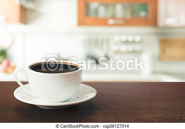 Hot coffee on tabletop in modern kitchen. Close up. - csp56127014