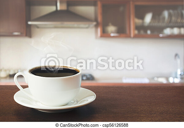 Hot coffee on tabletop in modern kitchen. Close up. - csp56126588