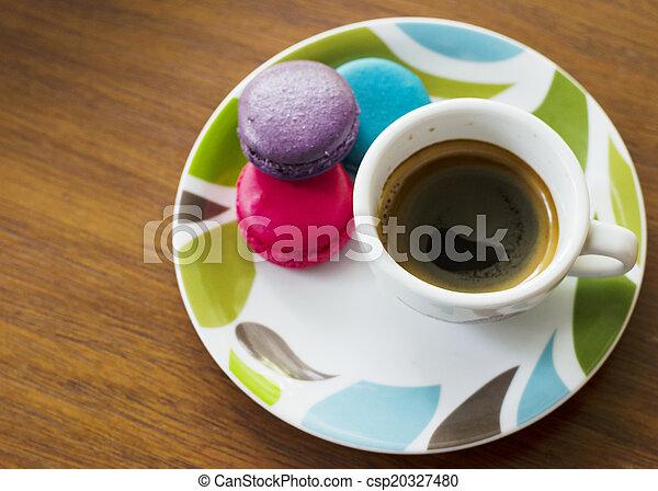 Hot Espresso coffee and macarons - csp20327480