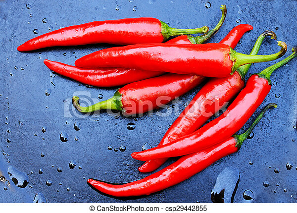 hot pepper on a background with drops of water - csp29442855