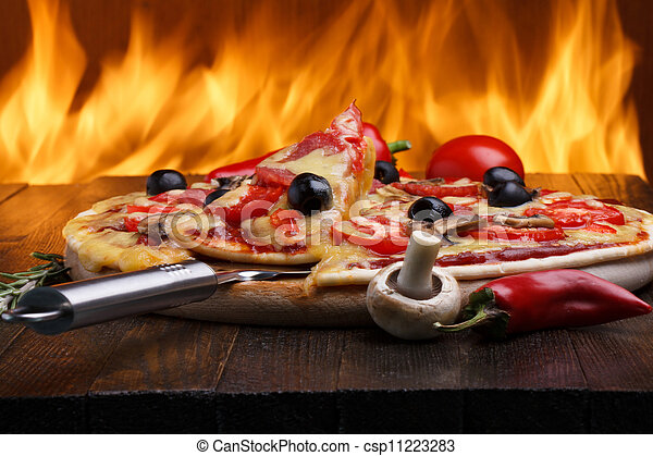 Hot pizza with oven fire on background - csp11223283