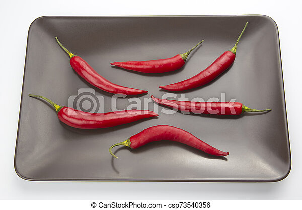 Hot red pepper on a gray plate - csp73540356