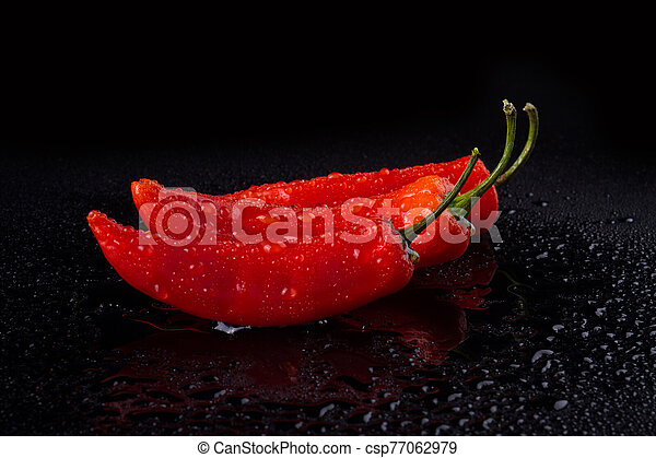 Hot red peppers with tails. - csp77062979