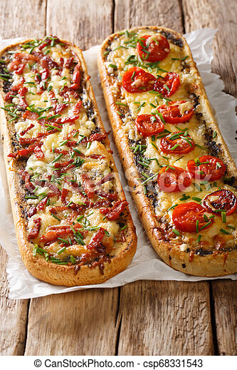 Hot sandwiches with bacon, mushrooms, tomatoes and cheese close-up on parchment. vertical - csp68331543