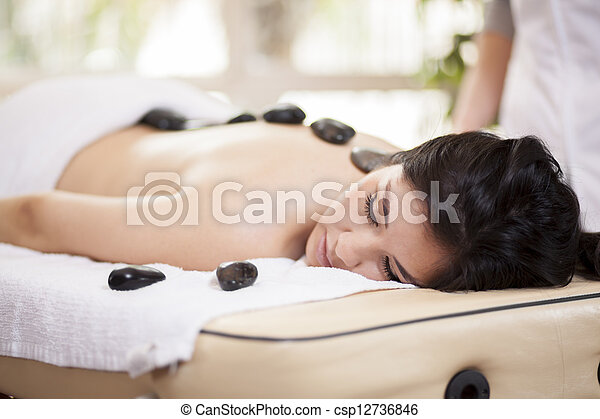 Hot stone massage at a spa - csp12736846