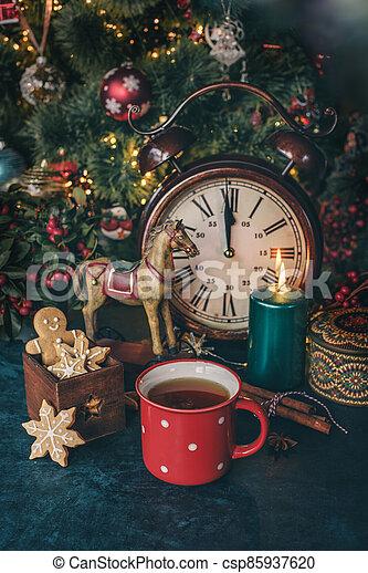 Hot tea with christmas cookies - csp85937620