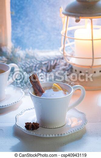 Hot tea with orange and cinnamon for Christmas - csp40943119
